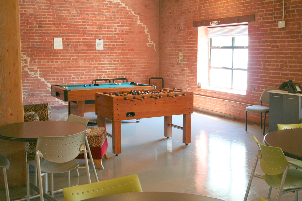 break room with foosball table and pool