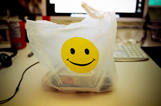 takeout bag with smiley face