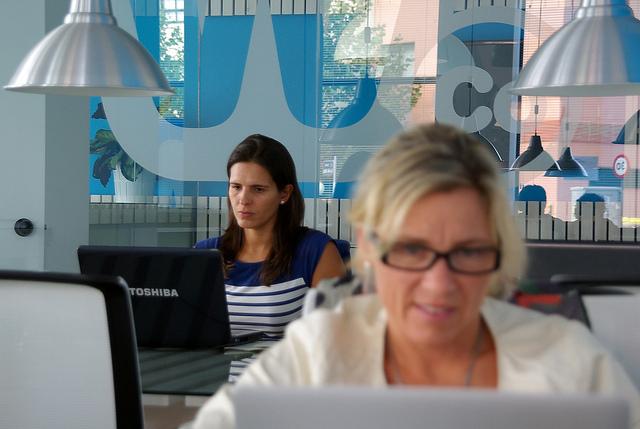 hardworking women on laptops