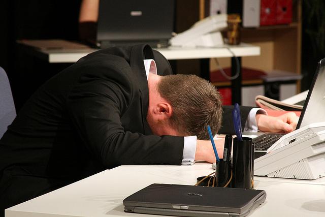 office worker facedown on desk