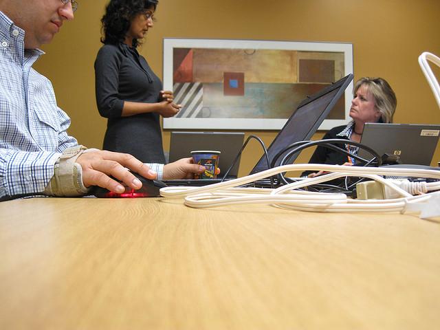 coworkers talking during meeting break