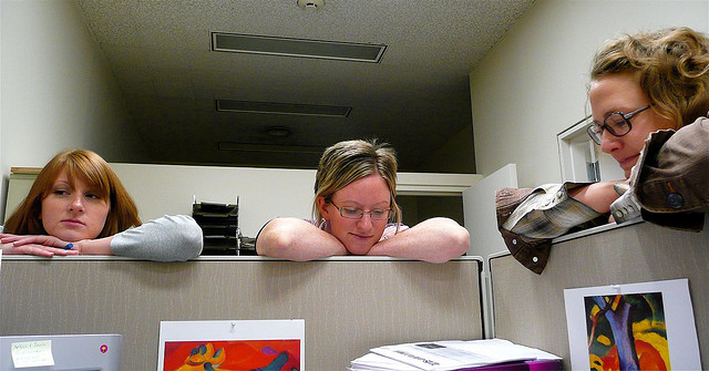 tired coworkers around cubicle
