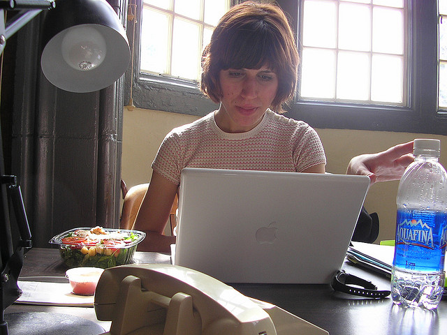 woman working with salad for lunch